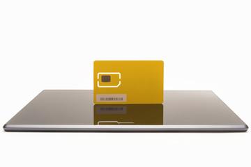 Modern yellow sim card on tablet
