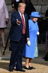 Britain's Queen Elizabeth and U.S. President Donald Trump walk through the Quadrangle toward an entrance at Windsor Castle, Windsor
