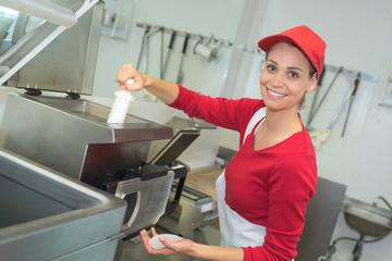 worker deep frying in industrial kitchen