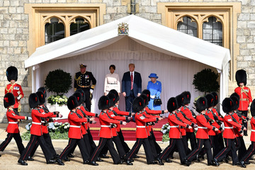 U.S. President Donald Trump and First Lady Melania Trump stand with Britain's Queen Elizabeth on the dais in the Quadrangle at Windsor Castle, Windsor
