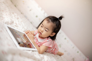child who enjoys watching tablet pc