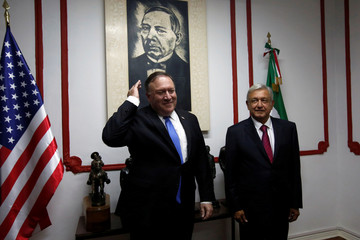 U.S. Secretary of State Mike Pompeo and Mexico's president-elect Andres Manuel Lopez Obrador pose for a picture before a meeting in Mexico City