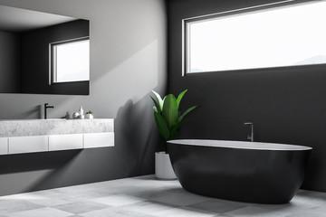 Dark minimalistic bathroom corner, window