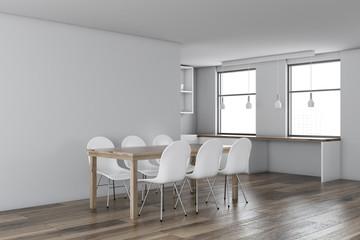 White dining room corner, wooden table