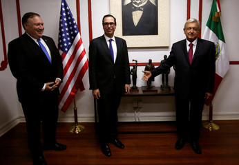 U.S. Secretary of State Mike Pompeo, Secretary of the Treasury Steven Mnuchin and Mexico's president-elect Andres Manuel Lopez Obrador are seen before a meeting in Mexico City
