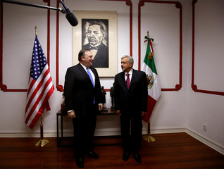U.S. Secretary of State Mike Pompeo and Mexico's president-elect Andres Manuel Lopez Obrador pose for a picture