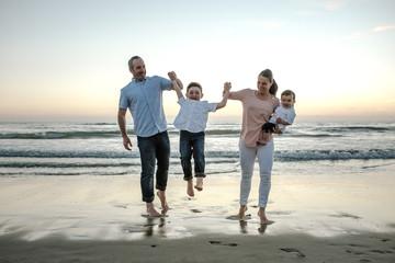 Smiling family enjoying beach