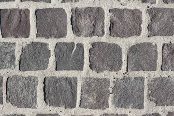 Small grey cobblestones with white pointing