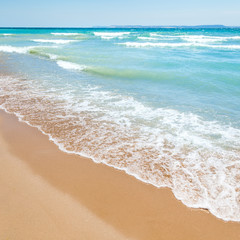 Beach With Blue Water And Sand