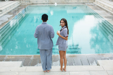 Man and woman by swimming pool