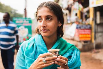 Woman drinking chai