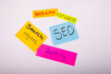 Assorted sticky notes with SEO ranking keywords website search engine optimization written on it