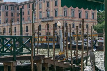 View of a little Pier and docked gondolas on canal grande in Venice italy