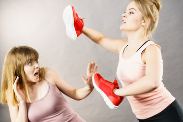 Women fighting with shoes