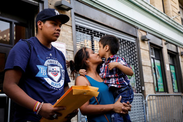Rosayra Pablo-Cruz, a Guatemalan mother who had been separated from her two sons, exits the Cayuga Center after being reunited with them in New York