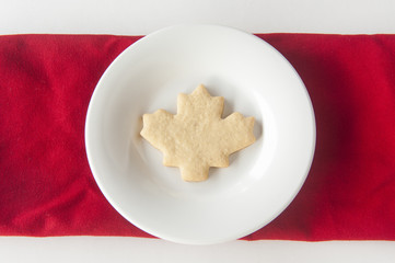 Maple Leaf Shaped Cookie on White Plate