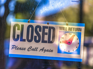 Closed sign with clock display