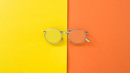Wall Mural - Topview Glasses on yellow and orange background.Color creative concept