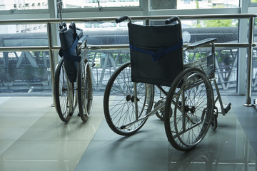 Two wheelchairs parking in the building