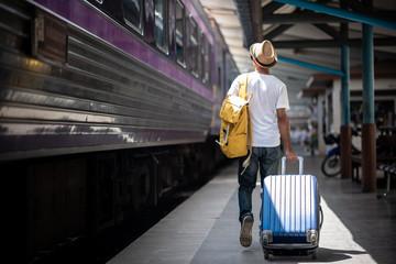 Traveler walking and waits train at train station