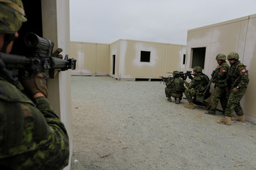 Canadian soldiers with the Royal 22e Regiment conduct assault operations during a Rim of the Pacific (RIMPAC) exercise with U.S. Marines at Camp Pendleton, California