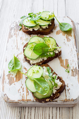 Healthy open sandwichis with fresh vegetabels and soft cheese