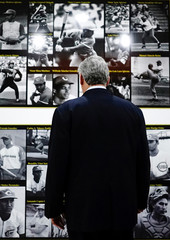 Cuban President Miguel Diaz-Canel looks at pictures at the Cuban Sports Hall during its inauguration in Havana