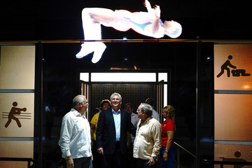 Cuban President Miguel Diaz-Canel (C) enters the Cuban Sports Hall during its inauguration in Havana