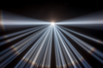Multiple white spotlights shining up into a black night sky, converging at the center of the frame with a created horizon and rainbow