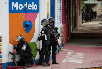 Riot police officers stand guard during clashes with anti-government in the indigenous community of Monimbo in Masaya, Nicaragua