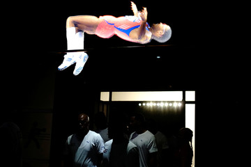 Athletes walk under an image of former Cuban high jumper athlete Javier Sotomayor as they enter the Cuban Sports Hall after its inauguration in Havana