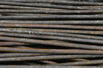Old, rusty and brown metal rods background surface