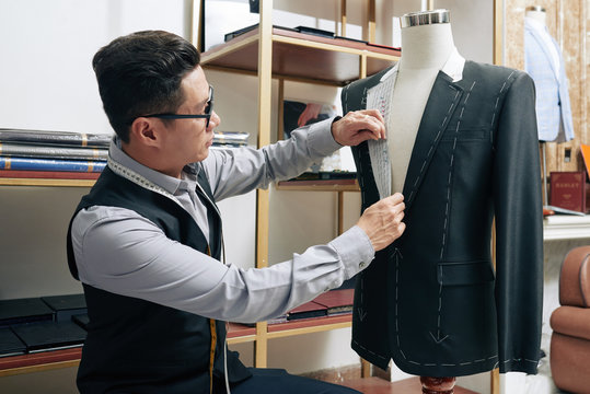 Tailor working on jacket