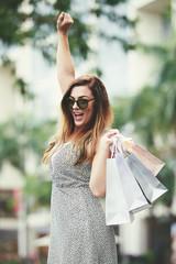 Excited female shopaholic