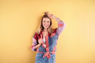 Wall Mural - Beautiful young woman posing on color background. Summer fashion