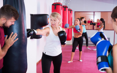 mature woman who is training with punching bag