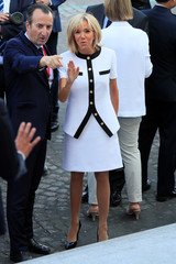 Brigitte Macron, wife of French President Emmanuel Macron, arrives to attend the traditional Bastille Day military parade on the Champs-Elysees in Paris