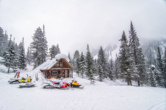 Hut in the mountains of Lake Baikal during the snowfall