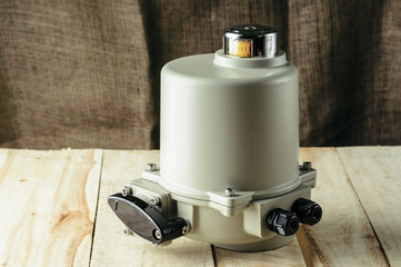 Small electric drive (actuator) gray colour for valves. Isolate . Еxplosion-proof. . Caption: open, closed.