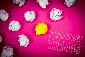 Writing note showing  Technology Trends. Business photo showcasing Trending Modern Viral Advanced Development Trendy New Pink ground white paper lumps shadow yellow lob outline letters.
