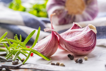 Garlic Cloves and Bulbs with rosemary salt and pepper.