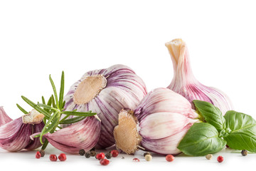 Garlic Cloves and Bulbs with rosemary and pepper.