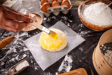 Baker hands smears butter