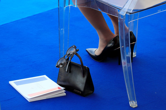 The handbag and eyeglasses of Brigitte Macron, wife of French President Emmanuel Macron, are seen as she attends the traditional Bastille Day military parade on the Champs-Elysees Avenue in Paris