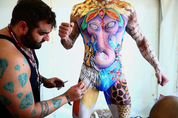 "Make-up artist Jonathan Pavan from Brazil works on model Thiago during the ""World Bodypainting Festival 2018"" in Klagenfurt"