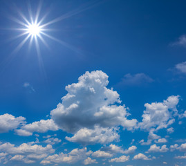 blue sky with clouds and sparkle sun, natural background