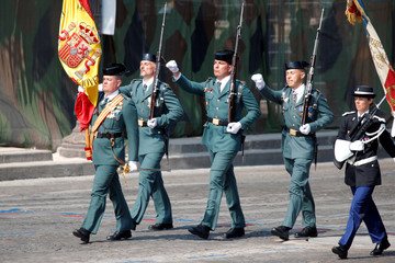 Members of Spain's Guardia Civil of Valdemoro march with French Gendarmes during the traditional Bastille Day military parade on the Champs-Elysees in Paris