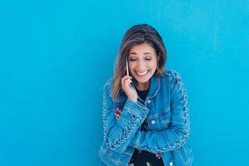 Young woman enjoying a mobile phone conversation