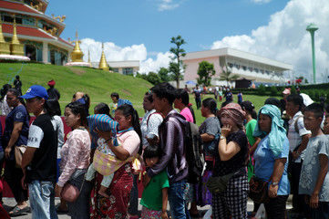 Ethnic minorities line up at a temple fair, in the northern province of Chiang Rai