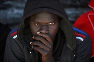 A migrant looks on after arriving on a rescue boat at the port of Tarifa